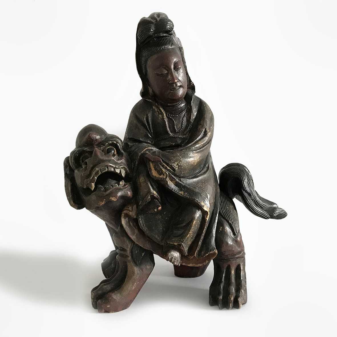 Wooden Guanyin on a Lion | wood | China | Quing Dynasty | basedonart gallery